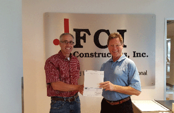 United Power co-op giving energy rebate check to FCI Constructors, Inc.